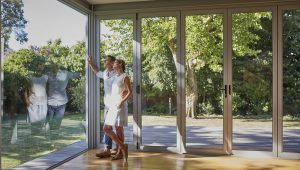 couplelookingoutwindow-GettyImages-596568507-094cac26c0c44793928f74e15ae25e65